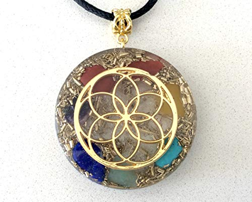 Orgone energy pendant necklace with golden seed of...