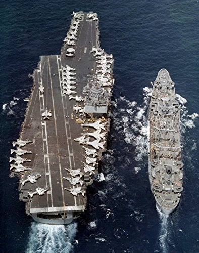 A U.S. Navy aircraft carrier USS Enterprise (CVAN-65) being replenished by the fleet oiler USS (Us Aircraft Carrier Fleet)