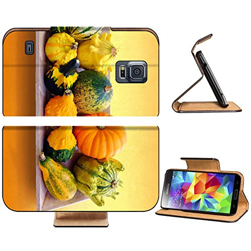 Samsung Galaxy S5 Close up of Colorful multiple pumpkin variety on wooden tray against orange IMAGE 33694471 by MSD Customized Premium Deluxe Pu Leather generation Accessories HD Wifi 16gb 32gb Luxury Protector Case