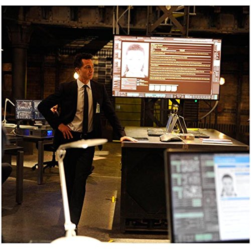 24: Live Another Day Benjamin Bratt as Steve Navarro in Suit Jacket and Tie Standing Near Large Computer Monitor 8 x 10 inch photo ()