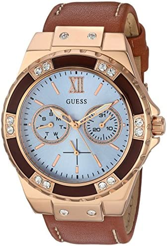 GUESS Women s Stainless Steel Leather Casual Watch with Day and Date Display, Color Rose Gold-Tone Brown Model U0775L7