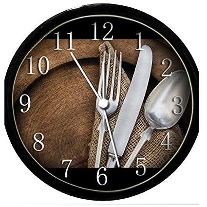 Brilla en la oscuridad reloj de pared - cuchara, cuchillo y ...