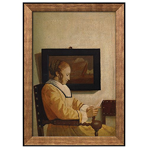 A Young Woman Reading by Johannes Vermeer Framed Art