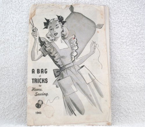 RARE 1945 COPY OF [ A BAG OF TRICKS FOR HOME SEWING ] FEATURES WARTIME PHOTOGRAPHS OF PRIZE WINNING IDEAS COOPERATING IN THE NATIONS EFFORT TO CONSERVE AND SALVAGE FOR VICTORY.