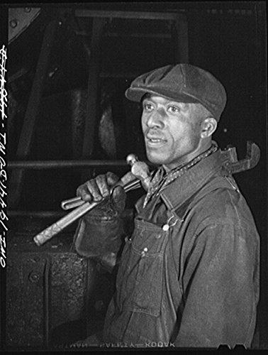 1943 Photo Shopton, near Fort Madison, Iowa. Otis Johnson, machinist's helper in the Atchison, Topeka and Santa Fe Railway roundhouse Location: Iowa, Shopton
