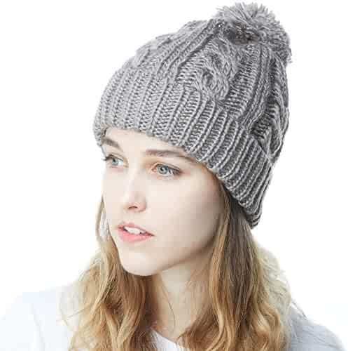 c7512169 The Hat Depot Winter Oversized Chunky Thick Stretchy Cable Knitted Pom Pom Beanie  Fleece Lined Hat