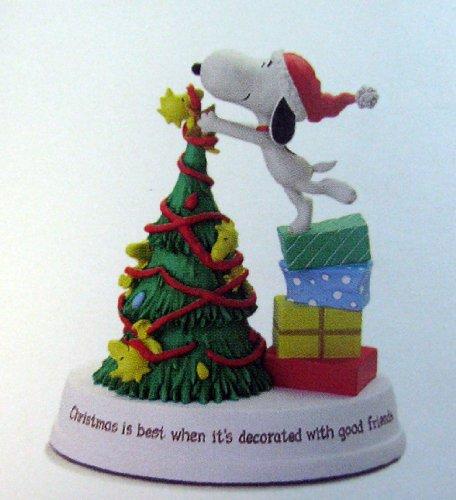 amazoncom hallmark 2012 christmas xkt1051 snoopy decorating the tree figurine home kitchen - Snoopy Decorations For Christmas