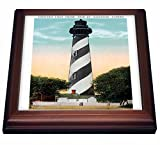 """Anastasia Light house, St. Augustine, Florida Trivet is measuring 8"""" W x 8"""" H x .75"""" D. Made of solid wood with padding on back that protects your furniture. Framed trivet comes with 6"""" x 6"""" ceramic gloss tile attached to the wood frame."""