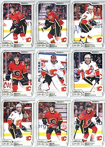 2018-19 O-Pee-Chee Hockey Calgary Flames Team Set of 15 Cards: Johnny Gaudreau(#12), Dougie Hamilton(#56), Matthew Tkachuk(#92), Sean Monahan(#114), Mikael Backlund(#143), Mark Giordano(#176), T.J. Brodie(#203), Sam Bennett(#239), Michael Frolik(#273), Mark Jankowski(#306), Mike Smith(#344), Troy Brouwer(#387), Michael Stone(#428), Nick Shore(#460), Micheal Ferland(#495)