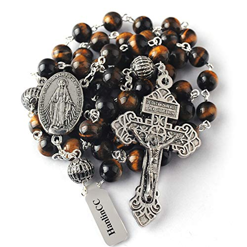 - HanlinCC 8mm Tiger Eyes Beads with 10mm Metal Our Father Beads Rosary with Miraculous Center Piece and Cross with Leather Gift Box