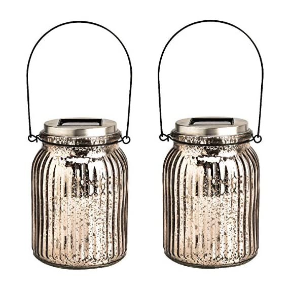 GIGALUMI Solar Powered Mercury Glass Mason Jar Lights, 2 Pack Hanging Solar Laterns Table Lights for Garden, Patio, Backyard.(Ideal Gift) - Crafted of glass with a silver mercury finish, our solar-powered lantern features a premium white LED lights that make the lamp look fantastic at night! Multiple Uses: 2 ways to install these solar lights, Hang or stand on a flat surface Solar powered Mason Jar Lights: No wiring. No AC current. Store energy from sun rays during daytime and automatically turn on at night. Illuminating for up to 8 hours with a full charge - patio, outdoor-lights, outdoor-decor - 511KCB2950L. SS570  -