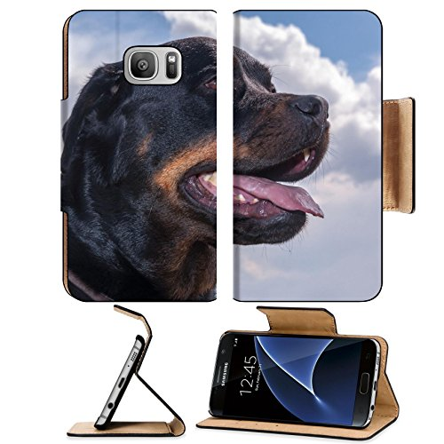MSD Premium Samsung Galaxy S7 Flip Pu Leather Wallet Case IMAGE ID: 13302375 Portrait of a Rottweiler dog looking forward against a cloudy sky (Christmas Behaviour Cards)