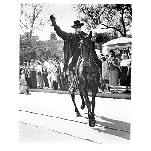 Guy Williams as Zorro Riding Horse Down Street Waving to Crowd 8 x 10 inch photo]()