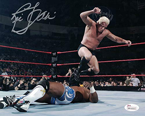 Ric Flair Autographed WWE Wrestling 8x10 Photo (Stomping) JSA
