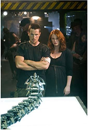 Terminator Salvation 2009 8 Inch By 10 Inch Photograph Christian Bale From Thighs Up Arms Crossed Next To Bryce Dallas Howard Looking At Piece Of Metal On Table Kn At Amazon S Entertainment Collectibles Store