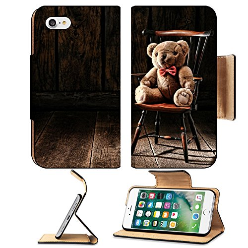 MSD Premium Apple iPhone 7 Flip Pu Leather Wallet Case Vintage soft and fluffy teddy bear stuffed animal toy sitting on an old miniature Windsor style armchair in an antique house atti