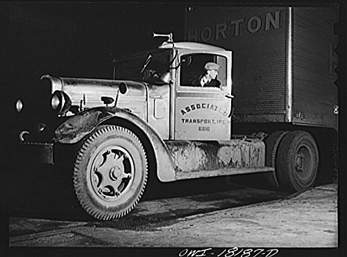 - 1943 Photo New York, New York. Associated Transport Company trucking terminal on Washington Street. Main line driver backing a truck which he is about to take to Baltimore Location: New York