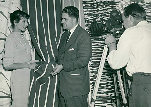 Vintage photo of Photographer Harry Lindberg starts coloring Erica Sundt while dir. Olle Kinch helps with the arrangement in NK39;s textile chamber