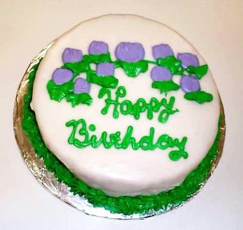 Vanilla-Strawberry-Chocolate Chip Lovers Cake Topped with White Chocolate Green Trim and Lavender Flowers