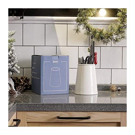 Sweese 801.101 Porcelain Utensil Holder for Kitchen, White 2 LARGE SIZE - It is 7.2 inches tall, and 5.9 inches in diameter of bottom and 4.3 inches of the top. Large enough to keep most of your daily utensils in it. MULTI-PURPOSE - Used for most kitchen utensils such as spatulas, spoons. Make everything tidily and easy to reach. It can also do double duty as a flower VASE. HEAVY & STURDY - Made of hard-paste porcelain, lead-free ceramic. Chip resistant and heavy duty so it will not tip over when it is hit accidentally.