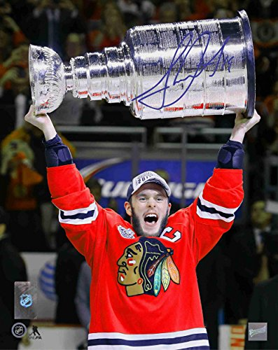 Jonathan Toews Autographed Photo - 16x20 Unframed 2015 Raising the Cup V - Autographed NHL Photos