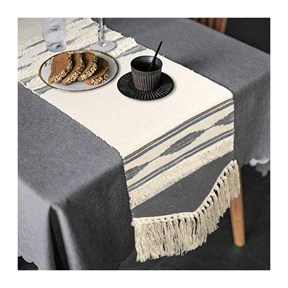 KIMODE Moroccan Fringe Table Runner 14 in x 87 in, Bohemian Geometric Cotton Handmade Woven Tufted Tassels Farmhouse Dinning Table Linen Machine Washable Minimalist Home Decorative - FITS TABLES FOR 6 to 8 PEOPLE: 14 in x 87 in ( Length 87 inch not include tassel ); macrame runner with extra in long handmade woven snazzy tassels on each side,gives a chic feeling and creates a relaxed mood in your room. CLASSY MATERIAL AND UNIQUE DESIGN: Fringe table runner use exquisite cutting with premium quality cotton and hemp fabric,add fringe and tufted vibe on this table runner,black and white colored lines looks more romantic and minimalist. MULTIFUNCTIONAL UTILIZATION: Suitable for most rectangular table, round table, and square table, and it not only moroccan decor dining table but also tea table, shoe cabinet, and TV stand, etc;great gift at housewarmings, holidays and birthdays. - table-runners, kitchen-dining-room-table-linens, kitchen-dining-room - 511sMmTtQpL. SS570  -