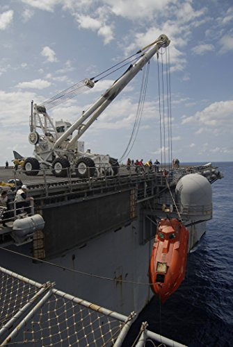the-lifeboat-from-the-maersk-alabama-is-hoisted-aboard-the-uss-boxer-lhd-4-to-be-processed-for-evi