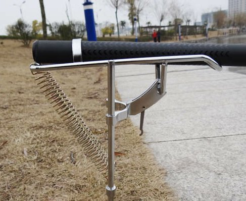 Fishing rod holder with automatic tip up hook setter in for Automatic fishing pole