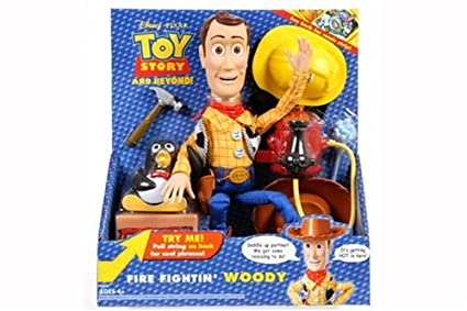 Amazoncom Hasbro Toy Story Woody Doll Fire Fightin Woody Toys
