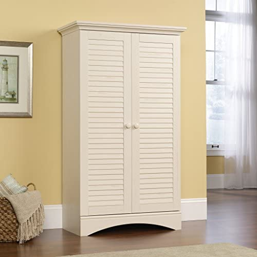 """Sauder Harbor View Storage Cabinet, Antiqued White finish, L: 35.43"""" x W: 16.73"""" x H: 61.02"""",    With this storage cabinet from the Harbor View collection, you can add extra storage space to any room in your home. Behind the two louver detailed doors is hidden storage that includes a full upper shelf and four adjustable shelves so you can store clothes, towels, blankets and more! Finished in a beautiful Antiqued Paint and detail with solid wood knobs, this stylish storage cabinet will keep you organized with ease."""