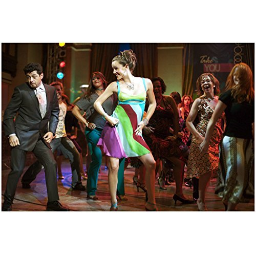 13 Going on 30 Jennifer Garner as Jenna Rink Wearing Striped Dress and Andy Serkis as Richard Kneeland Wearing Dark Suit Looking Down to Side Dancing with Dancers in Background 8 x 10 Photo