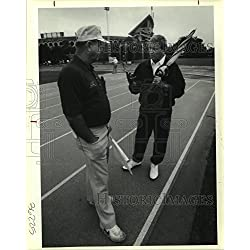 Historic Images 1991 Press Photo Tommy Henry and Donald Dunbar talking sports on the field. - 10 x 8 in