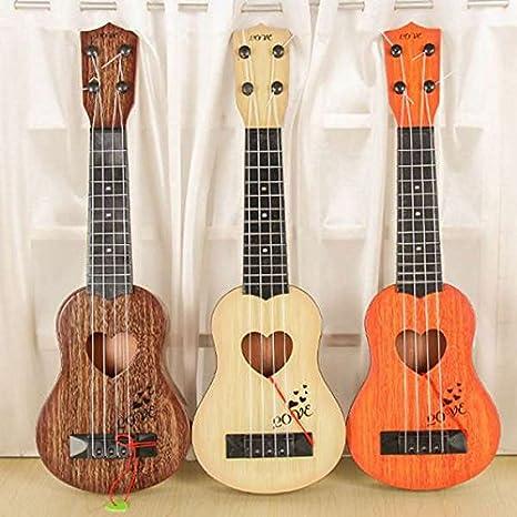 SODIAL Instrumento musical Mini ukelele Juguetes de guitarra para ninos Jugar un juego en escuela creativa Color aleatorio: Amazon.es: Instrumentos musicales