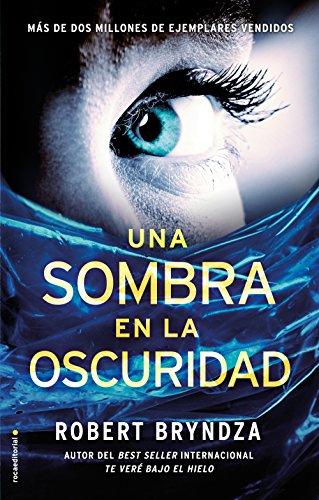 Una sombra en la oscuridad (Serie Erika Foster) (Spanish Edition) by [