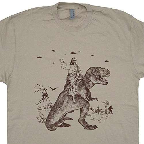 Jesus Riding a Dinosaur T Shirt Funny UFO Shirts Offensive Graphic Tee Evolution Charles Darwin Rude Alien Invasion Abduction