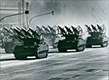 Vintage photo of Mobile rocket launchers, equipped with ground-to-air missiles, parading through the streets of East Berlin.