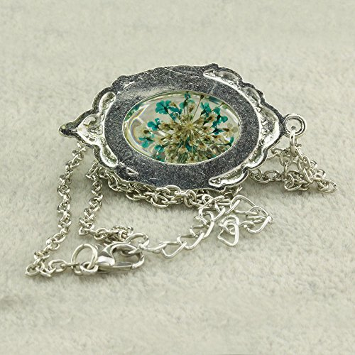 Fm42 Vintage Style Blue Dried Flowers Encased In Simulated Resin Oval Pendant Necklace Fn2038