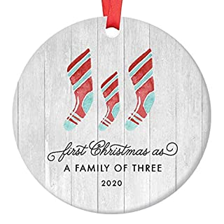 """First Christmas As A Family of Three Ornament 2020 Farmhouse Woodsy Newborn New Baby Parents Mom Dad Xmas Present Mommy Daddy Ceramic Porcelain Keepsake 3"""" Flat Circle with Red Ribbon & Free Gift Box"""