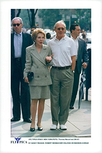 (Vintage photo of Nancy Reagan and Robert Mosbacher walk on Madison Avenue)
