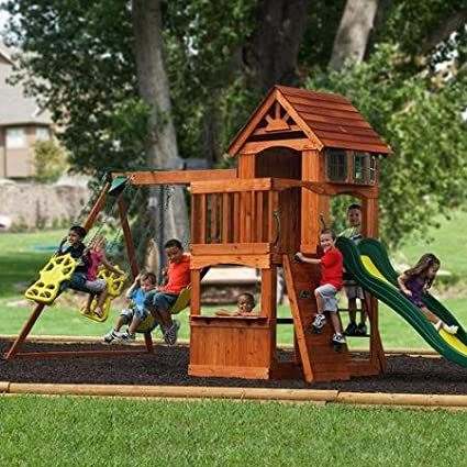 Your children will be able to enjoy active outdoor play all summer long  with this quality wooden swing set that features a covered play area,  swings, ... - The Top 50 Safest Backyard Swing Sets Safety.com