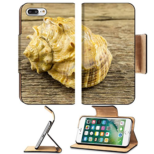 MSD Premium Apple iPhone 7 Plus Flip Pu Leather Wallet Case Sea shell on a wooden background Image ID 24516214 (Strombus Shell)