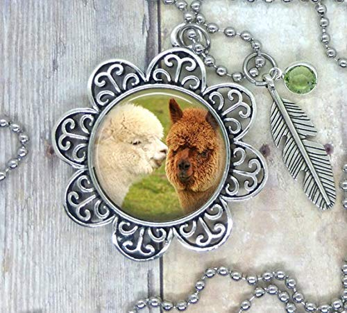 Alpaca's, Sweet Alpaca's, Lovely Image Setting in a Necklace, Backpack Clip Key Ring, Key Chain or Purse Clip. Adorned with a Light Green Swarovski Crystal and Feather Charm.
