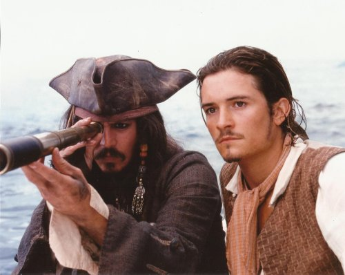 Johnny Depp, Orlando Bloom side by side Pirates of the Caribbean 8x10 Movie Photo Capt Jack looking through telescope ()