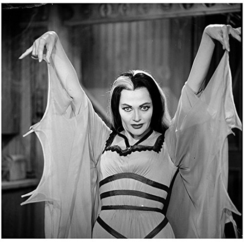 the-munsters-family-yvonne-de-carlo-as-lily-holding-up-bat-wings-8-x-10-photo