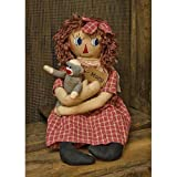 """Macy Doll wears a red gingham dress and bow and holds a small sock monkey doll. She has brown yarn hair and is 23½"""" tall."""