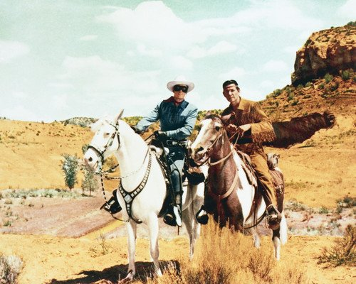 Clayton Moore and Jay Silverheels in The Lone Ranger riding together near hills outcrop 8x10 Promotional Photograph