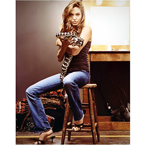 Angelina Jolie Wearing Tank Top Jeans Heels Sitting on Stool Holding Snake (8 Holding Tank)