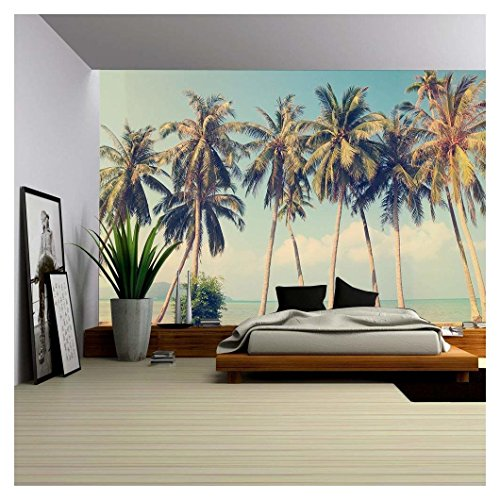 Vintage tropical palm trees on a beach