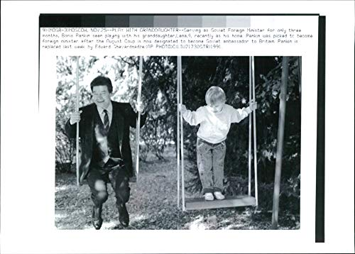 Granddaughter Collectible (Vintage photo of Boris Pankin with Granddaughter Lana.)
