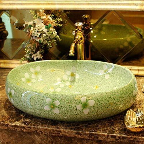 ZKS-KS ヨーロッパスタイルの手作りの磁器洗面花の形のカウンターセラミック浴室の洗面台の楕円形のバスルームのシンクセラミック洗面台